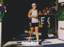 In this screen shot, Mary Zavanelli completes the Kona Ironman competition with a smile on her face.